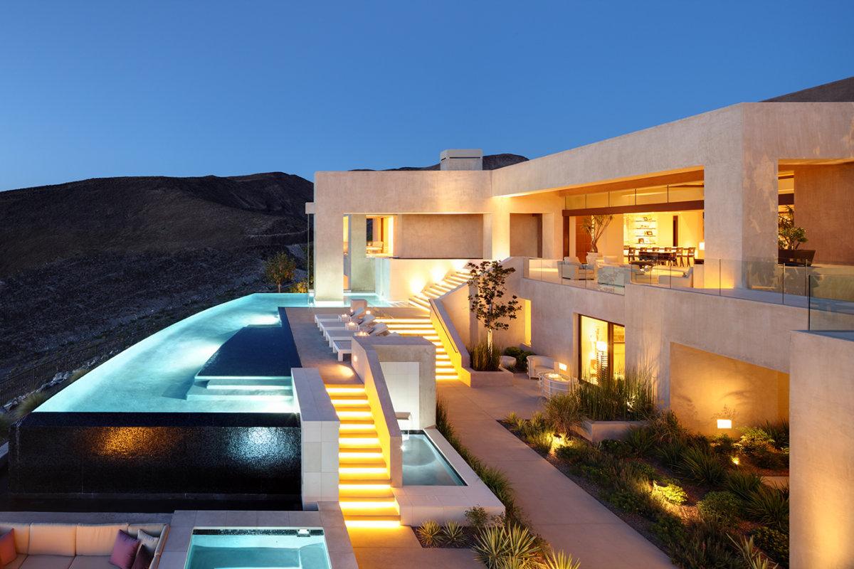 Custom Home At Macdonald Highlands Exterior With Pool At Night