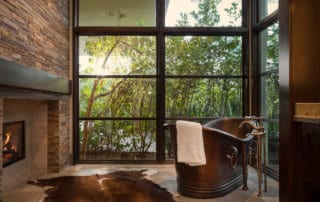 Custom Home and Pool House at The Ridges Bathtub and Fireplace